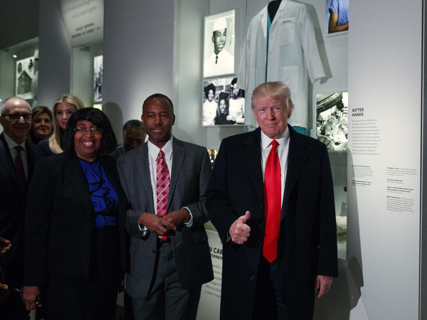 President Donald Trump gives a thumbs up during a tour of the National Museum of African American History and Culture with Housing and Urban Development Secretary-designate Dr. Ben Carson.
