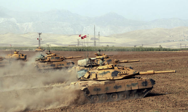 Turkish army tanks move during exercises in Silopi, near the Habur border gate with Iraq in southeastern Turkey on Monday.