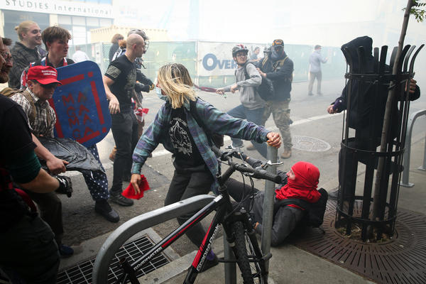 """Trump supporters clash with protesters at a """"Patriots Day"""" free speech rally on April 15, 2017 in Berkeley, California. More than a dozen people were arrested after fistfights broke out."""