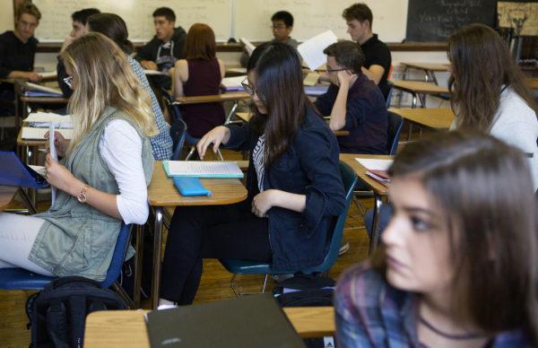 An international student listens during English class at John Bapst High School in Bangor.