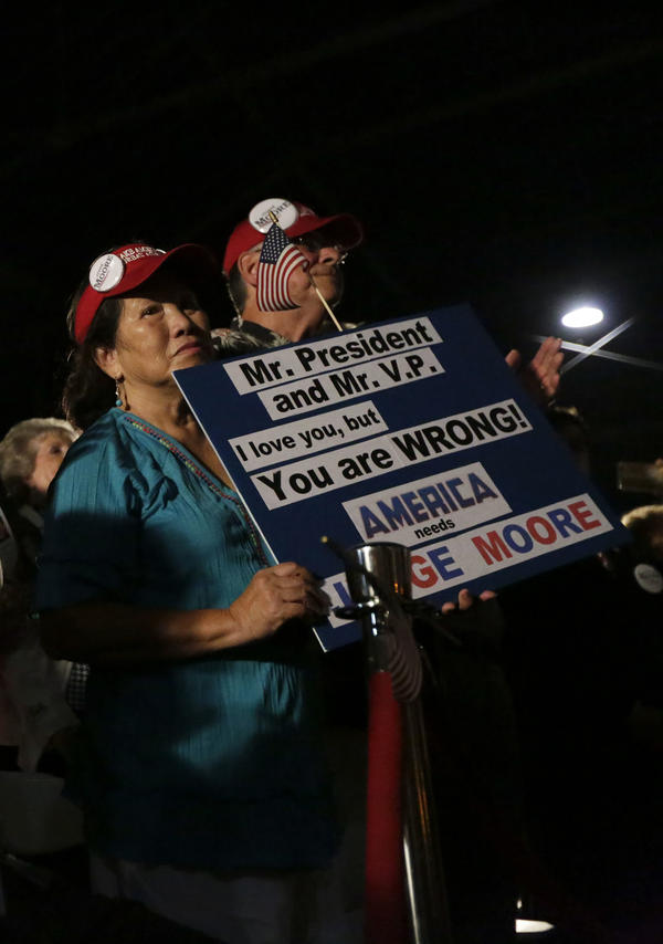 Supporters of Moore attend a rally on Sept. 21 with 2008 vice presidential nominee Sarah Palin.