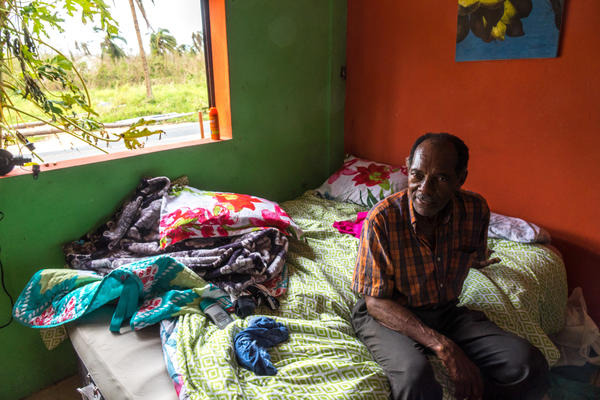 Santiago Quiñones Escalera, 73, sits on an air mattress he and his wife are sleeping on in Loiza , Puerto Rico, which sustained heavy damage by the destructive path of Hurricane Maria. Quiñones owns the bar/restaurant in front of the ocean and he decided he and his wife should ride the storm out there. Fortunately the building held up. They use a generator and solar-powered lighting.