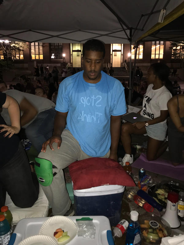 Dana Greene Jr. after more than 14 hours kneeling in protest at the University of Michigan diag in heat that reached nearly 90 degrees.