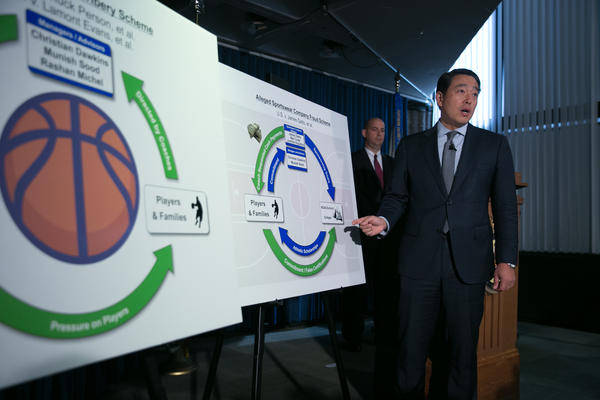 Acting U.S. Attorney Joon H. Kim speaks during a press conference at the U.S. Attorney's Office, Southern District of New York today. The acting U.S. Attorney announced Federal criminal charges against ten people, including four college basketball coaches, as well as managers, financial advisors, and representatives of a major international sportswear company.