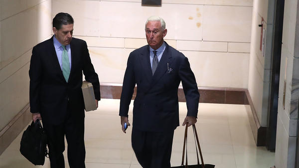Roger Stone (right), a former adviser to President Trump, arrives to appear before the House Intelligence Committee on Tuesday. Stone flatly denied any accusations of collusion between Russia and the Trump campaign.