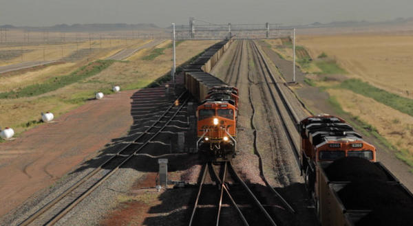 <p>File photo of coal trains traveling from a mine in Wyoming.</p>