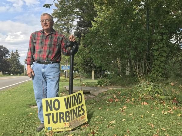 Gary Snell, Sr. is a vocal opponent of Avangrid Renewables' plan to put up to 40 turbines in Hopkinton and Parishville. This battered sign is posted in his front yard.