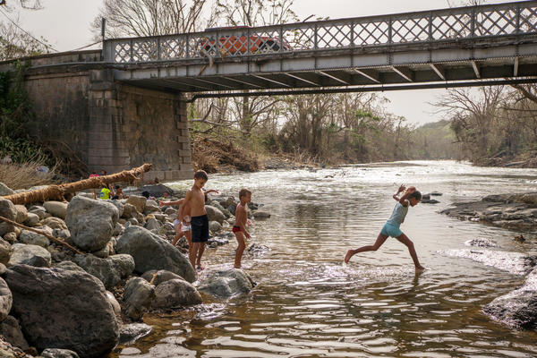 Children play in the Calabaza River in Coamo. In addition to washing up and doing laundry, some people came to the river to take a break from the post-storm cleanup