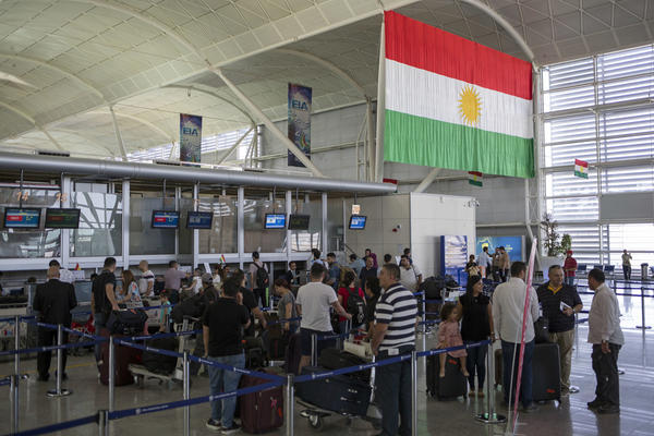 Travelers line up to check in at the Irbil International Airport in Iraq on Wednesday.