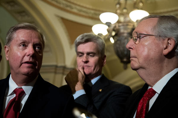 Sens. Lindsey Graham (from left), Bill Cassidy and Majority Leader Mitch McConnell take questions during a press conference Tuesday. Graham and Cassidy were among the co-sponsors of a proposal to overhaul the Affordable Care Act.