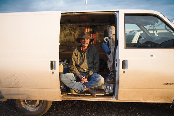 "A vandweller known as ""Ghost Dancer"" sits in the vehicle he calls home. (Jessica Bruder)"