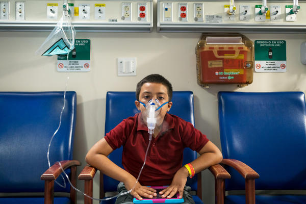 Jose Rolon Rivera, 7, receives medication for his asthma at the San Jorge Children's Hospital in Puerto Rico. The hospital only has enough fuel to power its emergency generators until Saturday, an administrator says.