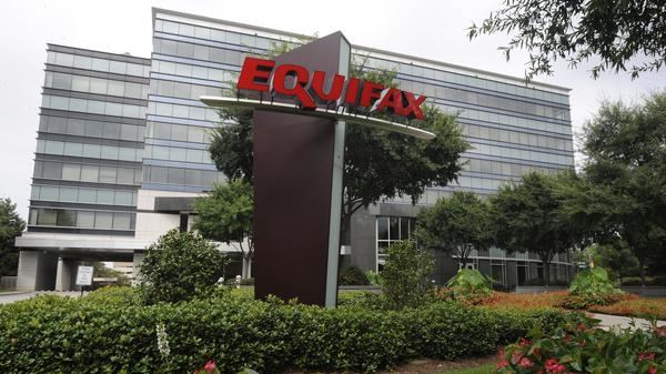 The Equifax Inc. headquarters are seen in Atlanta earlier this month. The credit reporting agency's interim CEO is apologizing to millions of consumers affected by a data breach.