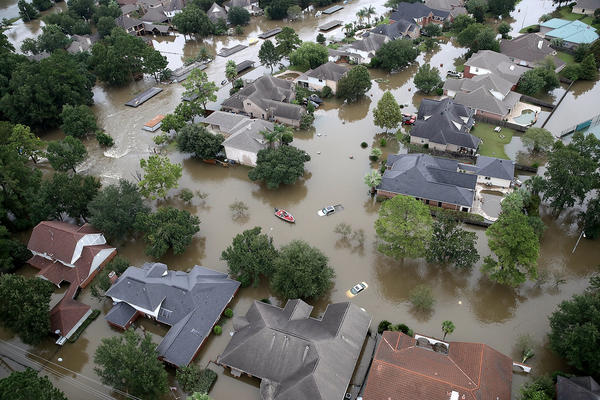 Flooded houses near Lake Houston on Aug. 30, after the storm called Harvey swept through. Sociologist Clare Cooper Marcus says our homes hold our emotional history — our memories, our hopes, our dreams and pain. In some ways our homes are who we are.