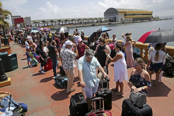 Thousands of people evacuating Puerto Rico after Hurricane Maria line up to get on a ship on Thursday. (Gerald Herbert/AP)