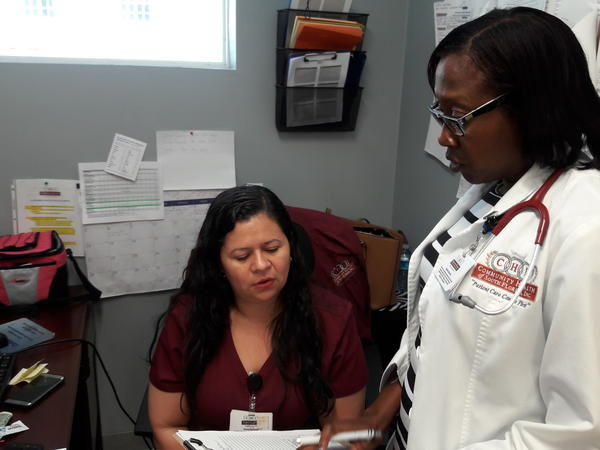 Dr. Marie Olette Celoge helps coordinate calls to get her patients' medical records.
