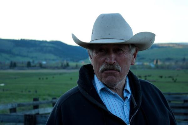 <p>Wallowa County rancher Dennis Sheehy at the Diamond Prairie Ranch near Enterprise, Oregon. Sheehy and a fellow rancher devised the first draft of Oregon's compensation plan back in 2010.</p>