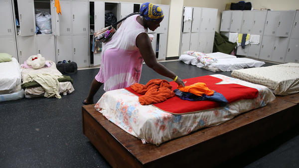 Residents of Barbuda were forced to flee when Hurricane Irma devastated their island on its way through the Caribbean. Here, Jackeline Deazle, whose house lost its roof and windows, is seen at a shelter in the Sir Vivian Richards Stadium last week in North Sound, on Antigua.
