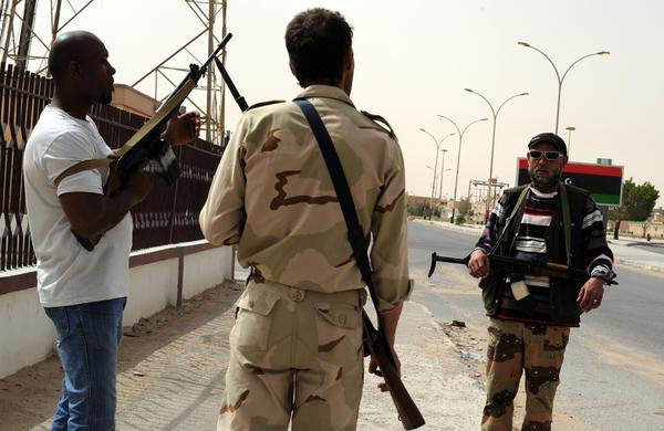 Libyan rebels patrol the streets of the almost deserted eastern Libyan city of Ajdabiya on May 1.