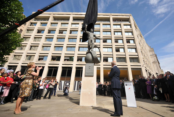 A statue of Russian cosmonaut Yuri Gagarin is unveiled in London on Thursday, as Gagarin's daughter, Elena (left) and Britain's Prince Michael of Kent look on. Gagarin became the first man in space April 12, 1961, as he orbited Earth.