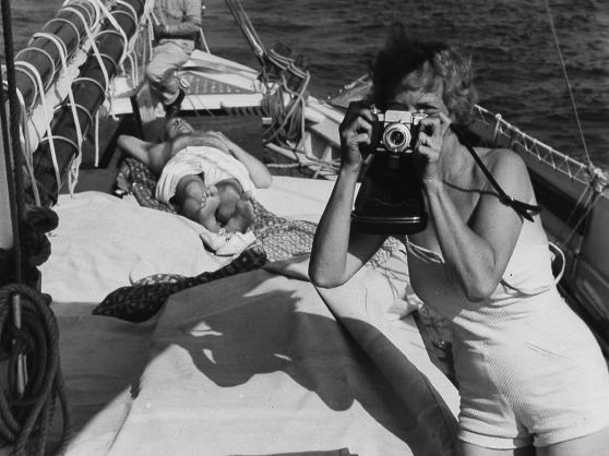 Aline Saarinen taking a photograph, circa 1955