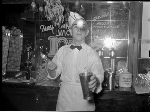 A 1939 soda jerk flips ice cream into malted milk shakes in Corpus Christi, Texas.