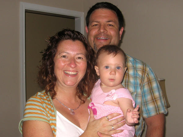 Tina and Patrick Gulbrandson, with their daughter, Waverly.
