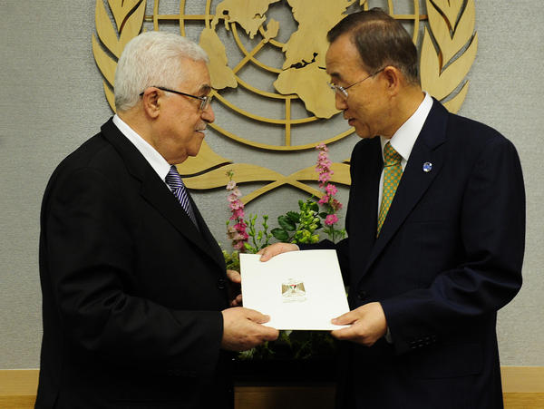 <p>Palestinian Authority President Mahmoud Abbas (left) hands a formal letter for Palestine to be admitted as a state to U.N. Secretary-General Ban Ki-Moon during the 66th General Assembly at U.N. headquarters in New York, Sept. 23. Palestinians now are pursuing full membership in other U.N. agencies.</p>