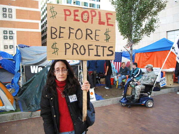 <p> Lisa Doherty lost her job in the mortgage business three years ago and says she can't find another job, in part because banks and credit unions aren't hiring people with bad credit scores.  </p>