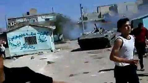 <p>In a frame grab from a YouTube video, Syrian protesters clash with an armored military in the southern Syrian town of Dera'a last Friday, according to people in the video. </p>