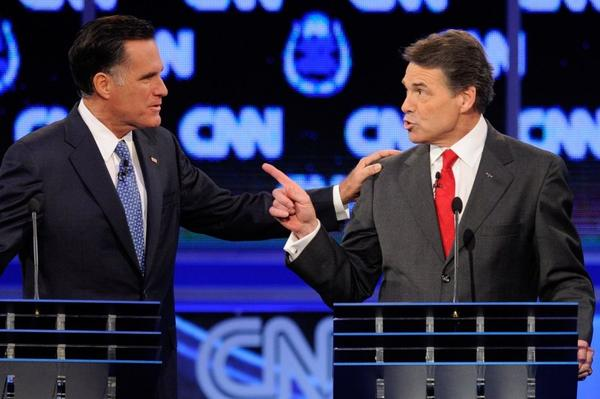 <p>Former Massachusetts Gov. Mitt Romney (left) and Texas Gov. Rick Perry got into a heated exchange about immigration during Tuesday's GOP presidential debate in Las Vegas. </p>