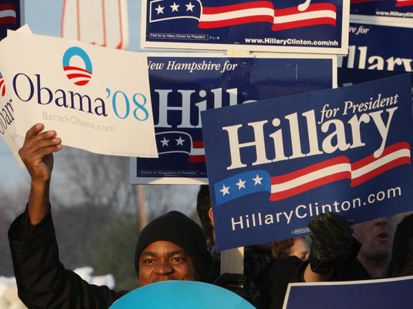 <p>In 2008, the primary battle between then-Sens. Barack Obama and Hillary Clinton dragged on for months. Above, supporters of Obama and Clinton hold signs outside a polling place in January 2008 in Nashua, N.H.</p>