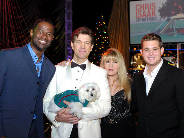 <p>Rodney the Maltese dog in a suit made by Jaime Custom Tailors. From left to right: Brian McKnight, Chris Isaak, Stevie Nicks and Michael Buble.</p>