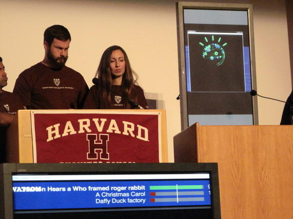 Harvard Business School's Jayanth Iyengar (far left), Jonas Peter Akins and Genevieve Sheenan held their own, but eventually lost to IBM's Watson in a game of <em>Jeopardy</em> at a conference on jobs and technology.