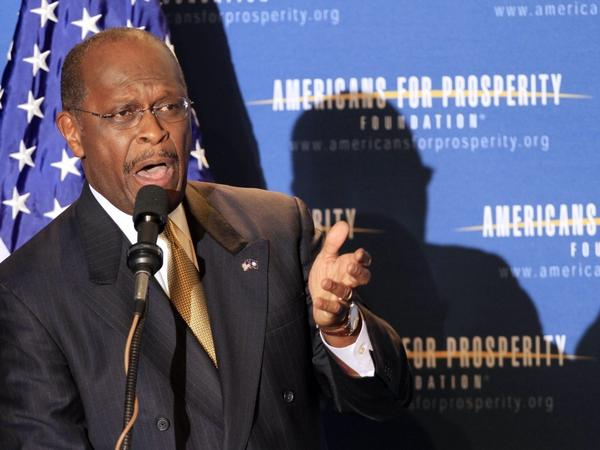 Republican presidential candidate Herman Cain speaks at a dinner in April sponsored by Americans for Prosperity in Manchester, N.H. Cain has close ties to the group, founded by billionaire businessmen David and Charles Koch.
