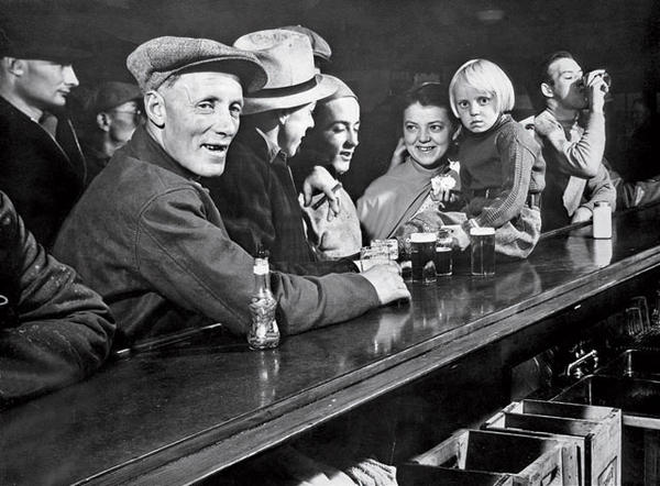 One of the photos from Margaret Bourke-White's cover story in the first issue of <em>Life: </em>Residents of a Fort Peck gather at a saloon.