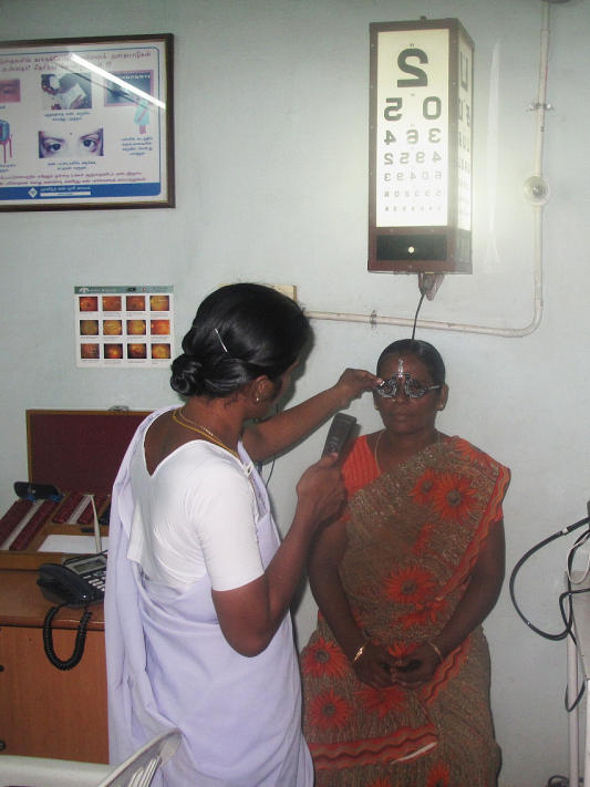 A woman receives an eye exam at one of Aravind's 36 small satellite eye care centers, in the village of Alanganallur, about 15 miles from Madurai.