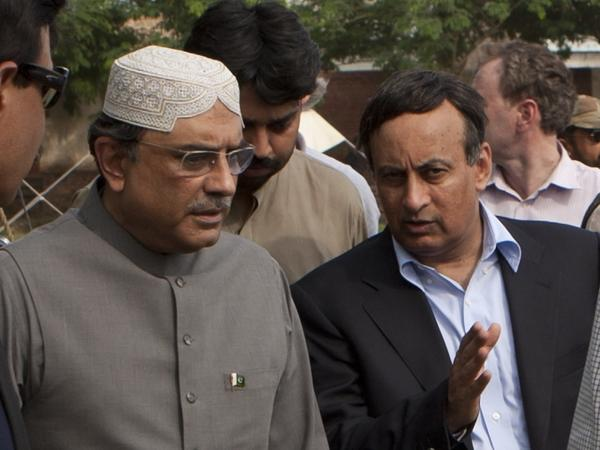 Hussain Haqqani, Pakistan's ambassador in Washington (right), talks to President Asif Ali Zardari in Multan, Pakistan, in August. Haqqani resigned over claims he wrote a memo to Washington asking for its help in reining in Pakistan's powerful military.