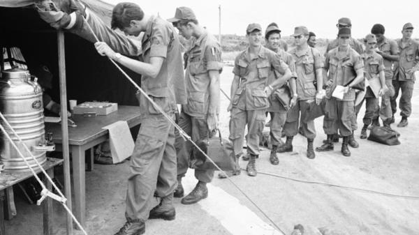 U.S. soldiers at Long Binh base, northeast of Saigon, line up to give urine samples at a heroin detection center in June 1971, before departing for the U.S.