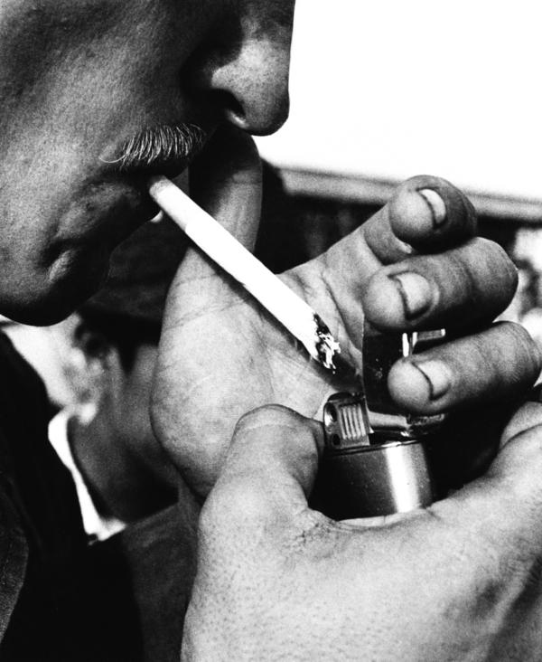 A GI lights up a cigarette in Saigon in 1971. He poured grains of heroin into the menthol cigarette, from which he had first removed some of the tobacco.