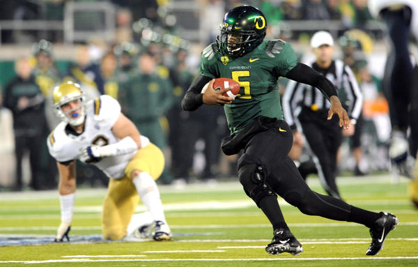 Quarterback Darron Thomas of the Oregon Ducks (right) threw for 30 touchdowns with only 6 interceptions this season. The Ducks beat UCLA in the Pac-12 Championship to earn a spot in the Rose Bowl, where they'll face Wisconsin.