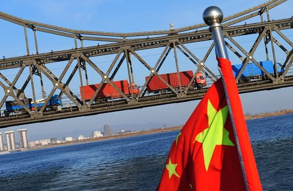 Trucks loaded with Chinese goods head across the Yalu Bridge and into North Korea one day after the memorial service for the late leader Kim Jong Il, at the Chinese North Korean border town of Dandong on December 30, 2011.