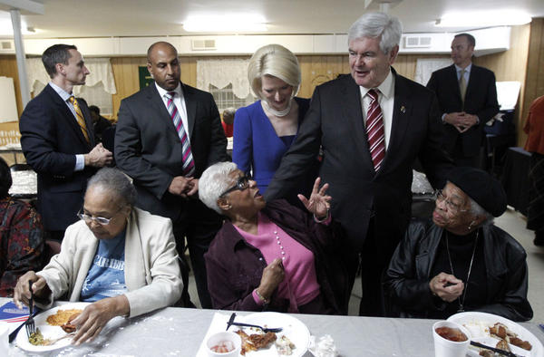 Republican presidential candidate former House Speaker Newt Gingrich, accompanied by his wife, Callista, meets with parishioners during an event Saturday at the Jones Memorial AME Zion Church.