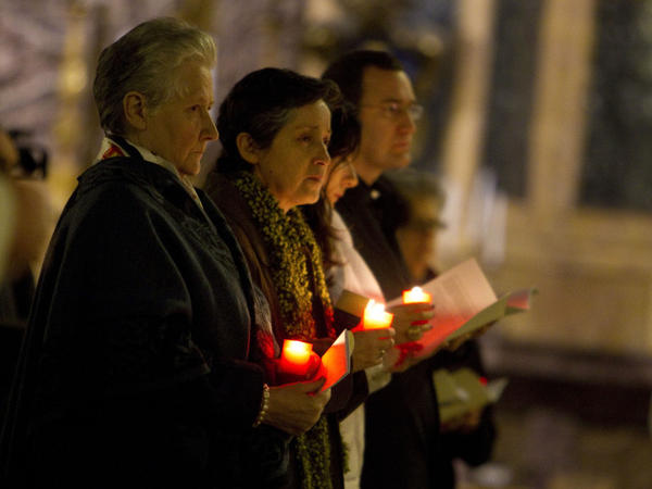 "Marie Collins (left), who was assaulted as a 13-year-old by a hospital chaplain in her native Ireland, attends a penitential vigil in Rome 's St. Ignatius Church on Tuesday. She was the only victim to attend the symposium, called ""Toward Healing and Renewal."""