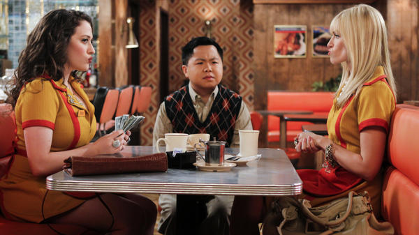 Han Lee (Matthew Moy), owner of the Brooklyn diner where Max (Kat Dennings, left) and Caroline (Beth Behrs, right) work, joins the two women as they count their earnings on <em>2 Broke Girls</em>.