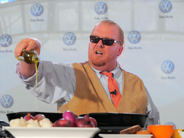 Chef Mario Batali prepares dishes for the crowd at the world premiere of Volkswagen's new Jetta compact sedan in New York City in 2010.