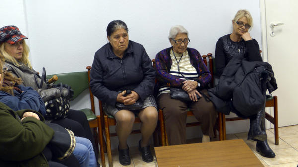 Patients sit in the waiting room of a free medical clinic in Perama, Greece, run by an international aid group, Doctors of the World, last month. Official unemployment in the port town is 80 percent, and many people are unable to afford food and medicine.