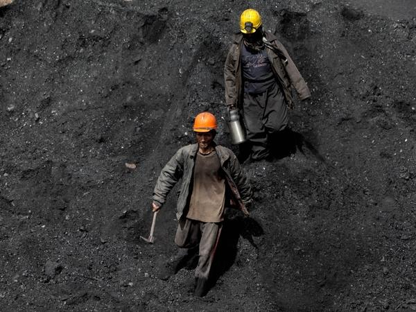 Afghan miners work a coal mine some 60 miles east of the western city of Herat, Afghanistan, in 2010.