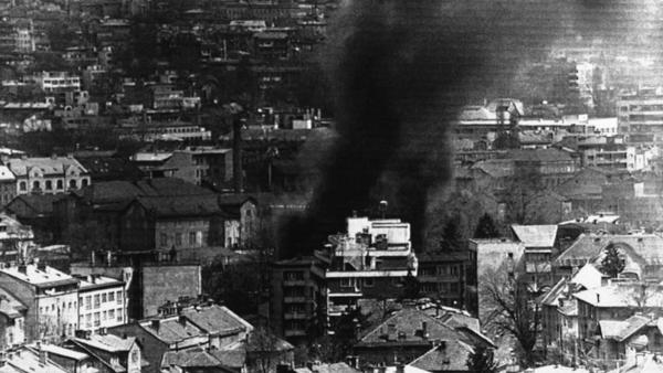 Twenty years ago this week, the Bosnian war began with the siege of Sarajevo, the capital. In this photo, smoke billows from a building in downtown Sarajevo, April 22, 1992, after a Serbian mortar attack.