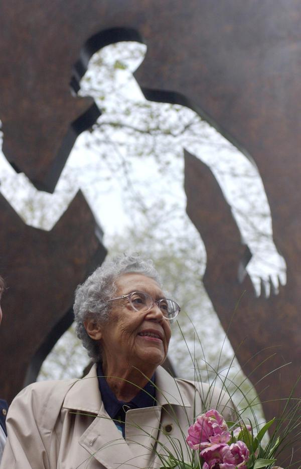 Sculptor Elizabeth Catlett shown in front of her <em>Invisible Man</em> sculpture in New York City in 2003.